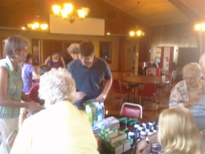 Parishioners assemble care packages for Bristol Faith in Action.